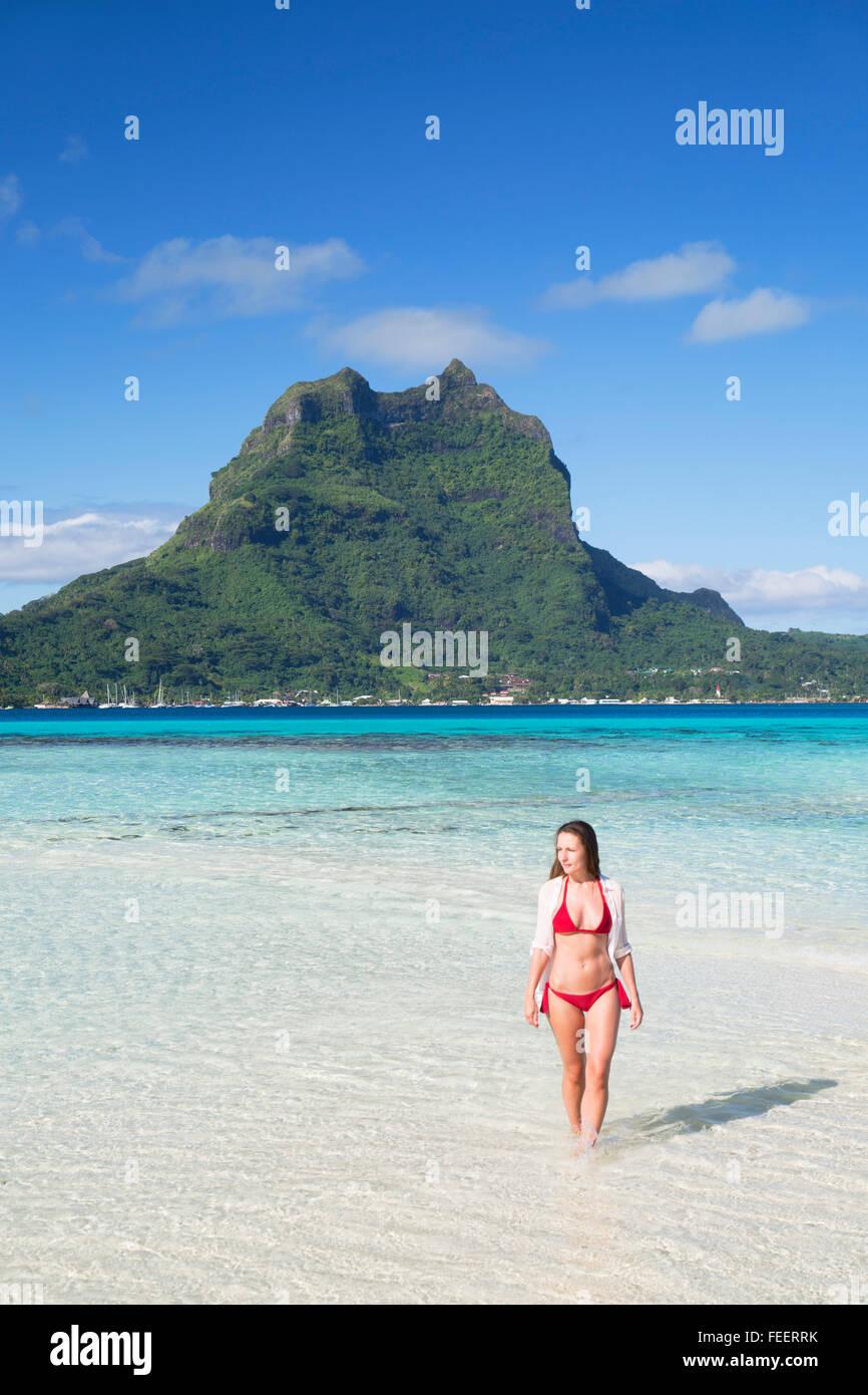 Woman on Motu Tapu, Bora Bora, Society Islands, French Polynesia Stock Photo