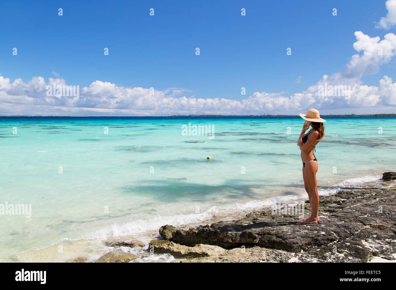 Woman on beach, Fakarava, Tuamotu Islands, French Polynesia - Stock Image
