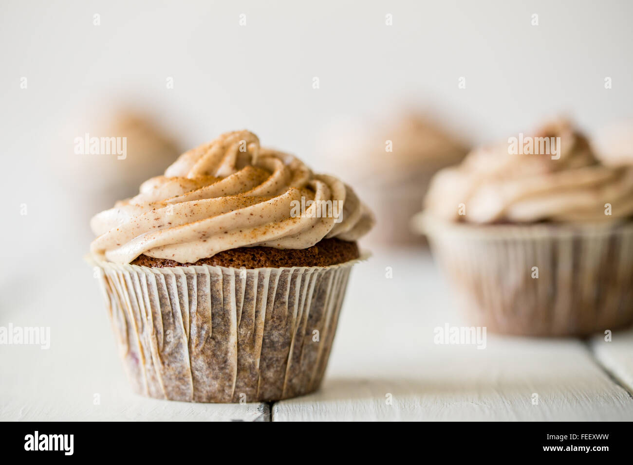 close up of a delicious cupcakes with mocca frosting - Stock Image