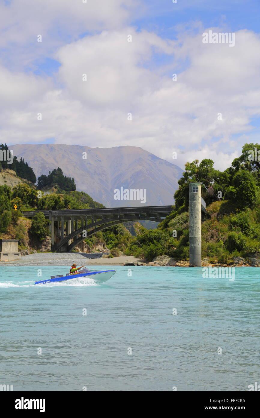 A man operating his jet boat on the Rakaia River near Windwhistle in Canterbury, New Zealand. Stock Photo
