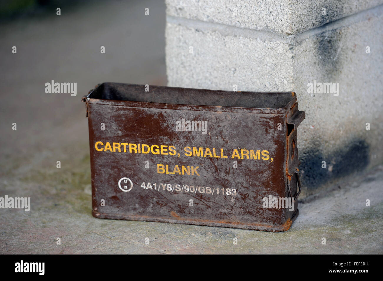 Discarded ammunition box at the MOD army training village near Brecon, Wales UK - Stock Image
