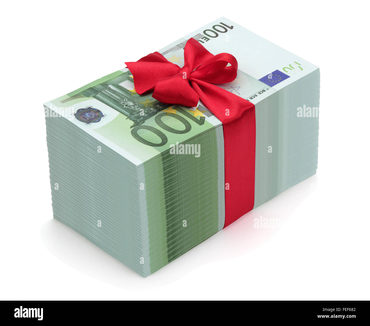 Pile of one hundred euro banknotes with red ribbon and bow, isolated on the white background, clipping path included. - Stock Image