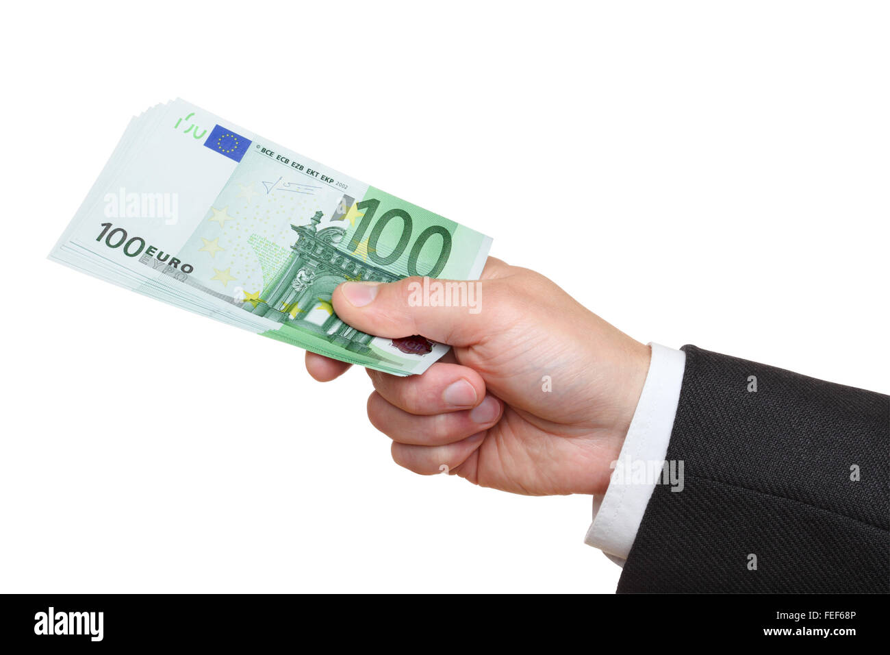Hand of businessman holding one hundred euro banknotes,  isolated on the white background, clipping path included. - Stock Image