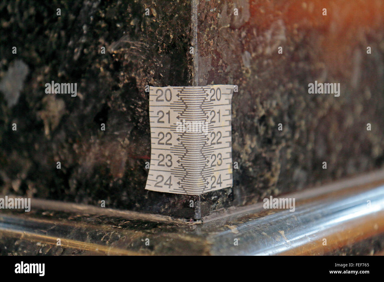 Measurement tape stuck to a marble column inside the Church of the Savior on Spilled Blood, St Petersburg, Russia. - Stock Image
