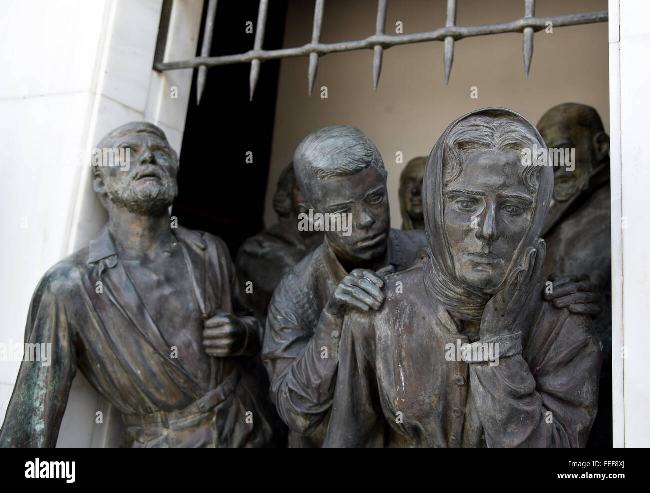 Bronze Statues on the liberty monument in the city of Nicosia in Cyprus. - Stock Image