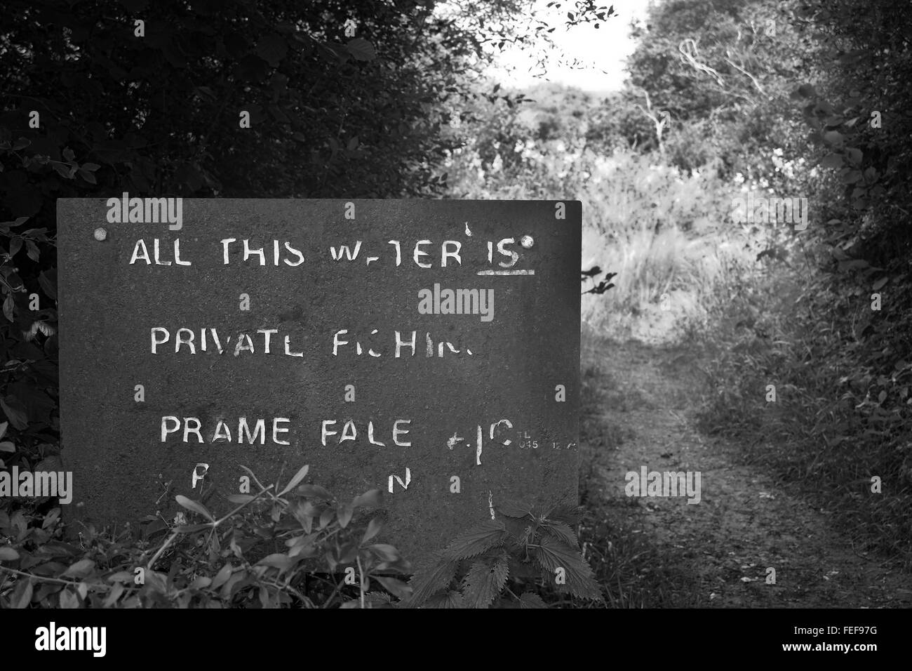 Well worn private fishing sign - Stock Image