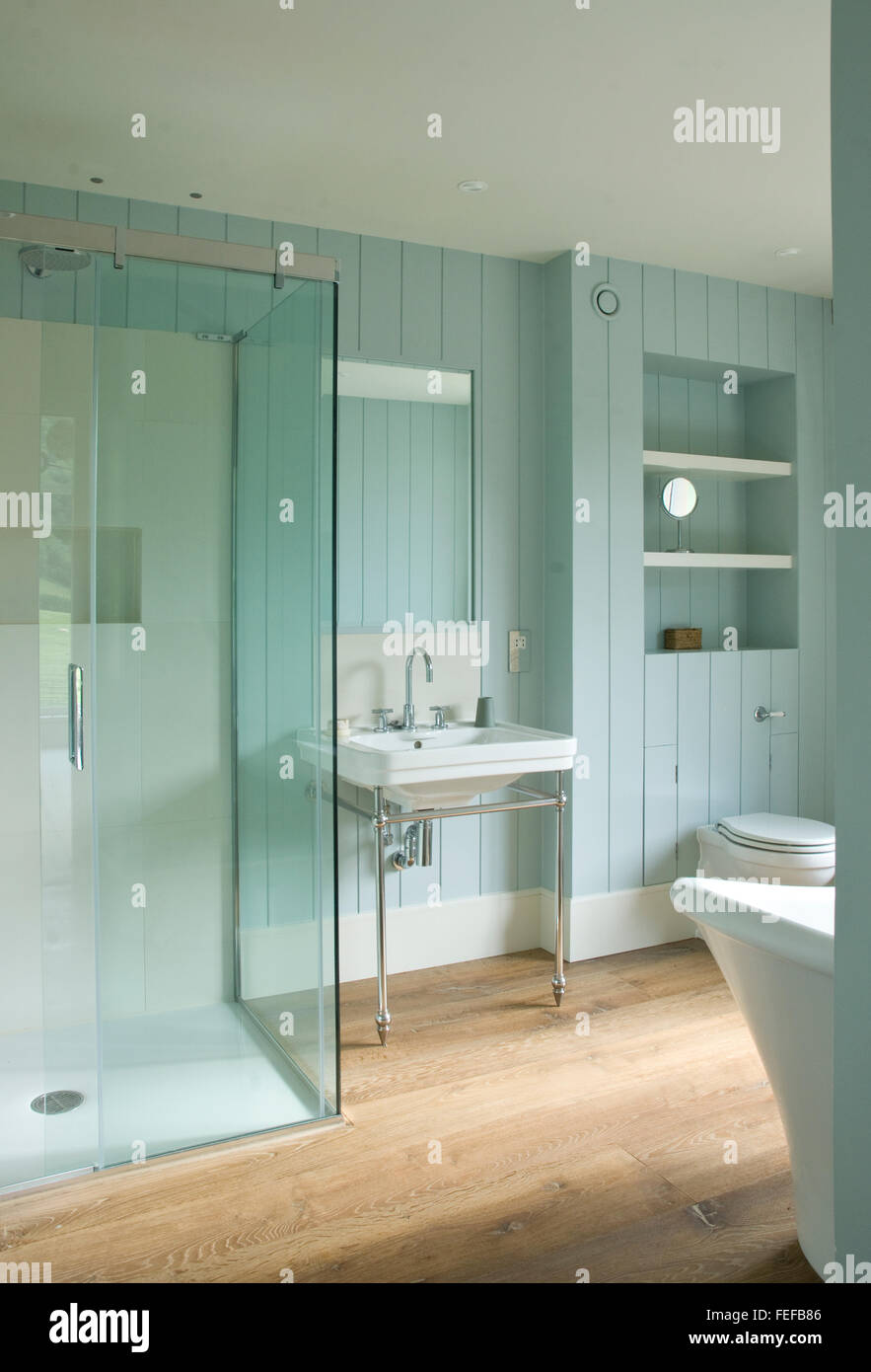 paneled bathroom, blue/green/pastel, shower cubicle, wood floor ...