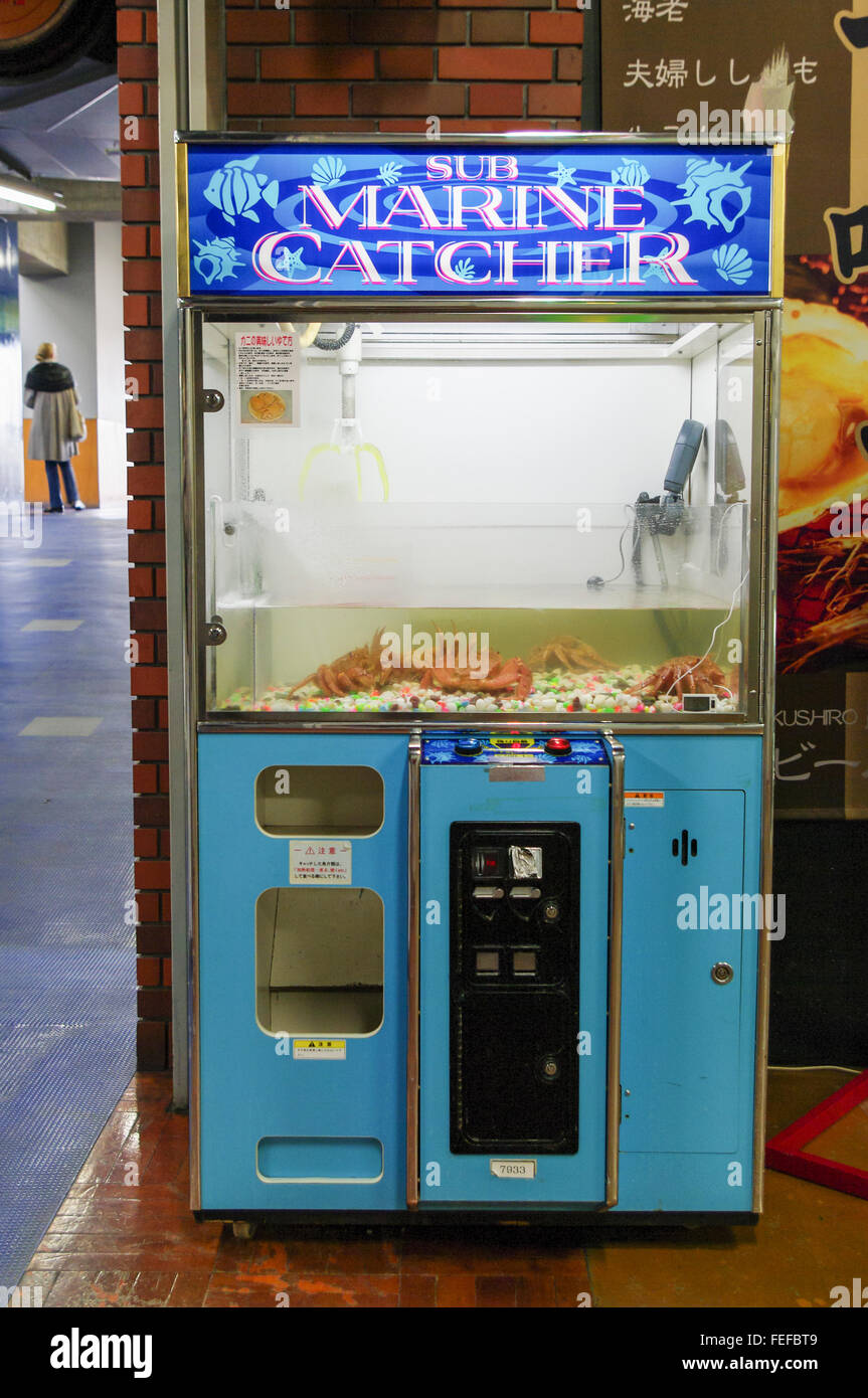 Sub Marine Catcher, an arcade claw crane machine for live crabs in Kushiro, Japan. - Stock Image