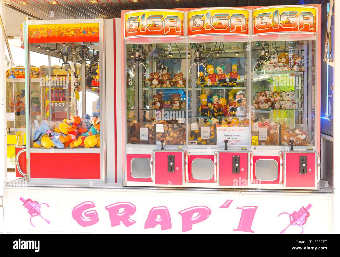 Paris, France - July 9, 2015: Arcade crane claw machine on an arcade at amusement park in Jardin des Tuileries, - Stock Image