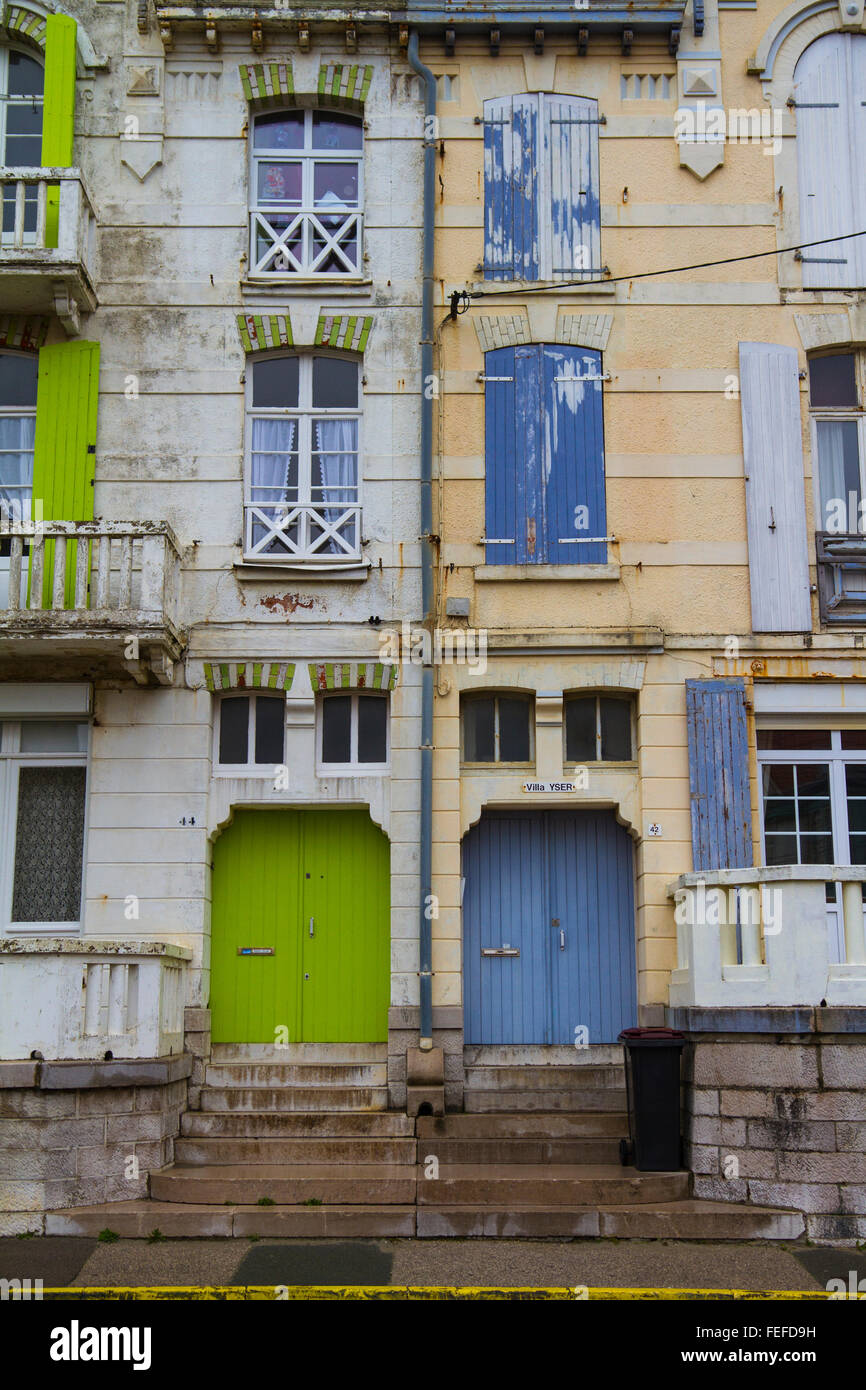 Wimereux, Derelict French house frontage with shuttered windows and peeling paint. - Stock Image