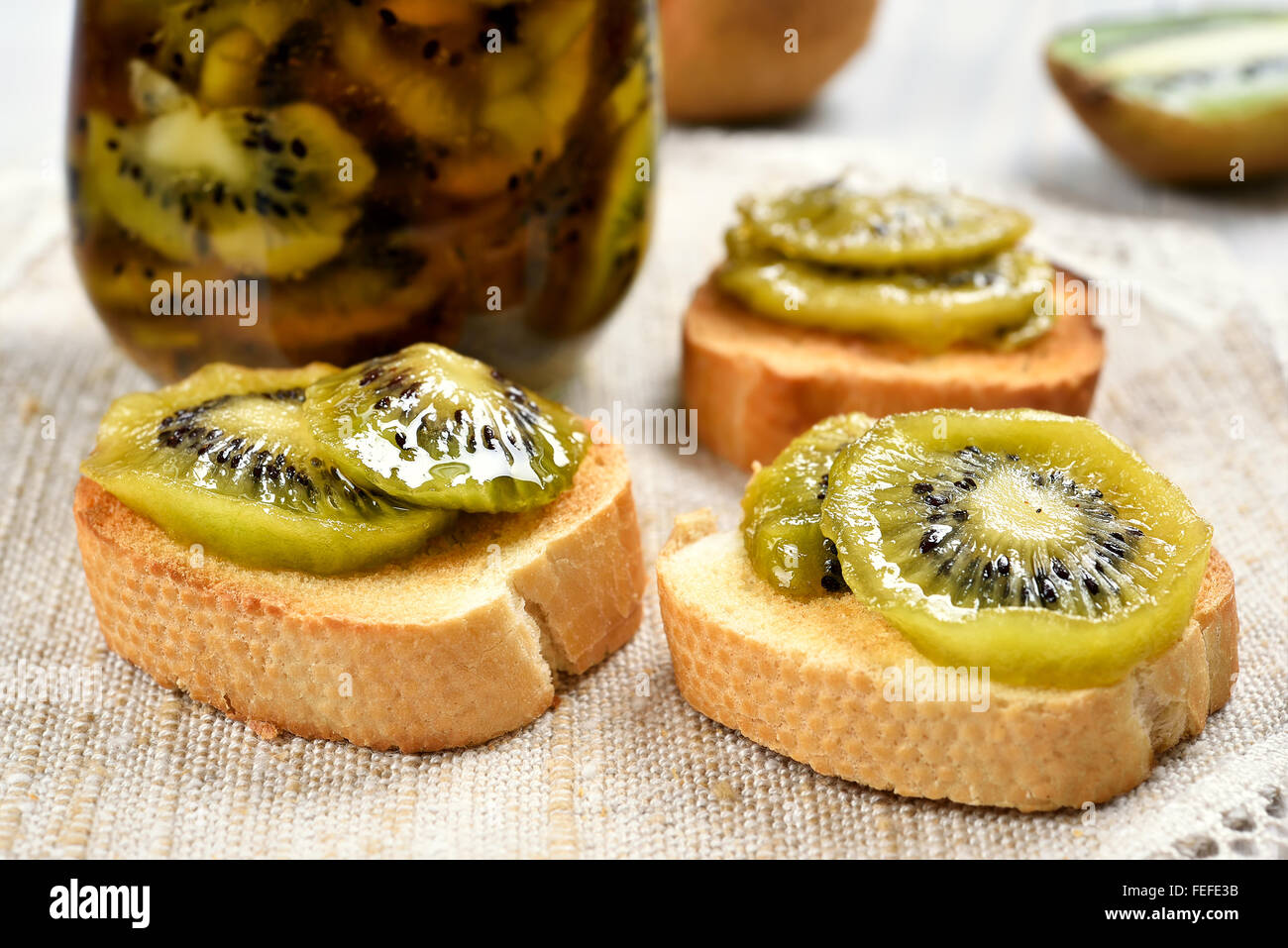 Sandwiches with canned kiwi, close up view - Stock Image