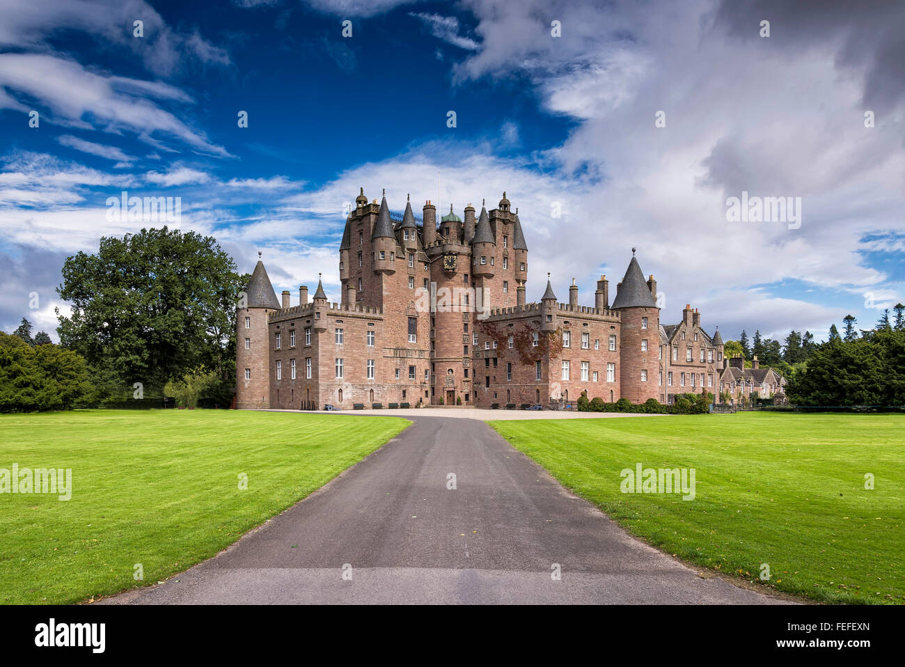 Glamis Castle is situated beside the village of Glamis in Angus, Scotland. It is the home of the Earl and Countess - Stock Image