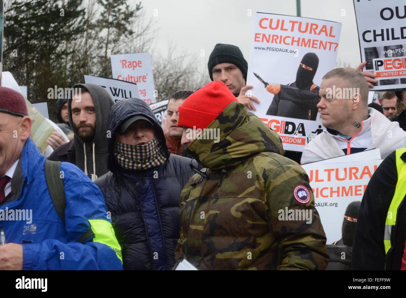 Birmingham, UK. 6th February, 2016. Protesters in face masks despite a clear request by organisers to not wear them. - Stock Image