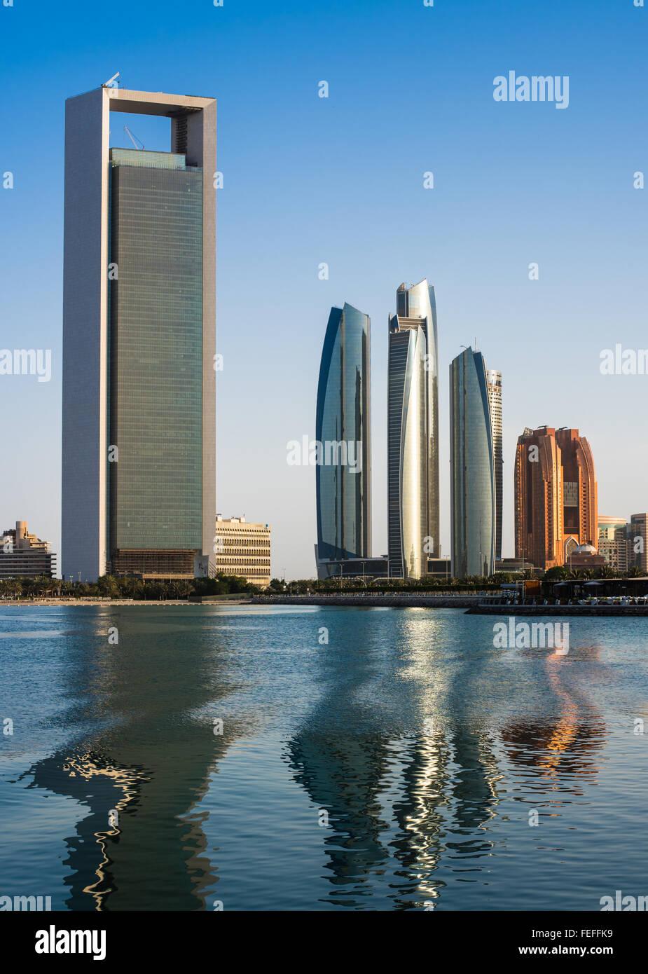 ADNOC and Jumeirah Etihad Towers at dusk, Abu Dhabi - Stock Image