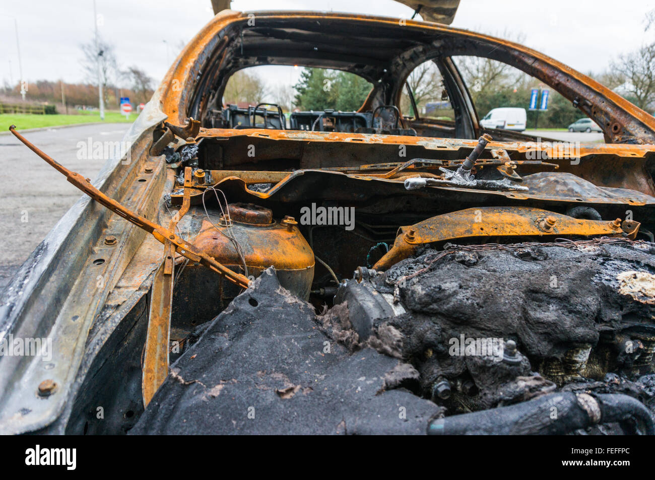 Abandoned fire damaged car Stock Photo