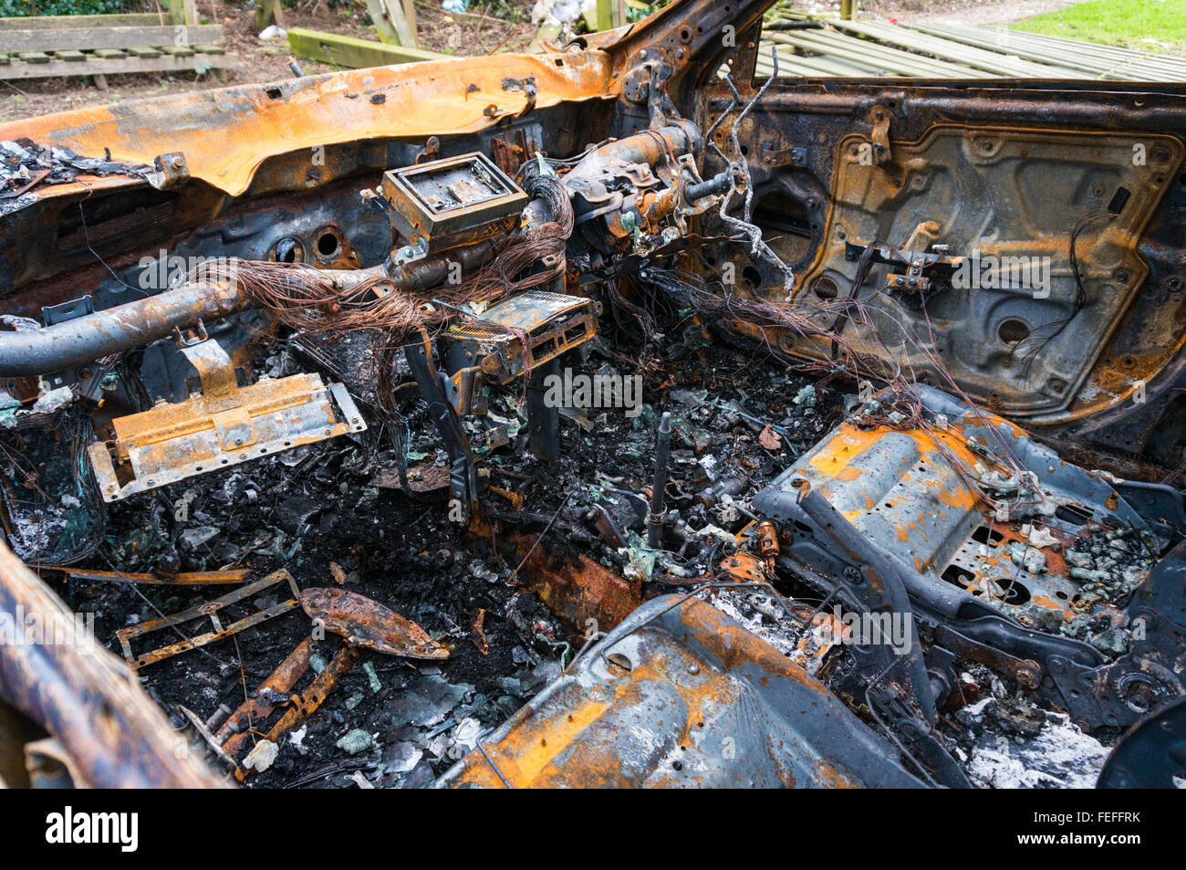 Abandoned fire damaged car - Stock Image