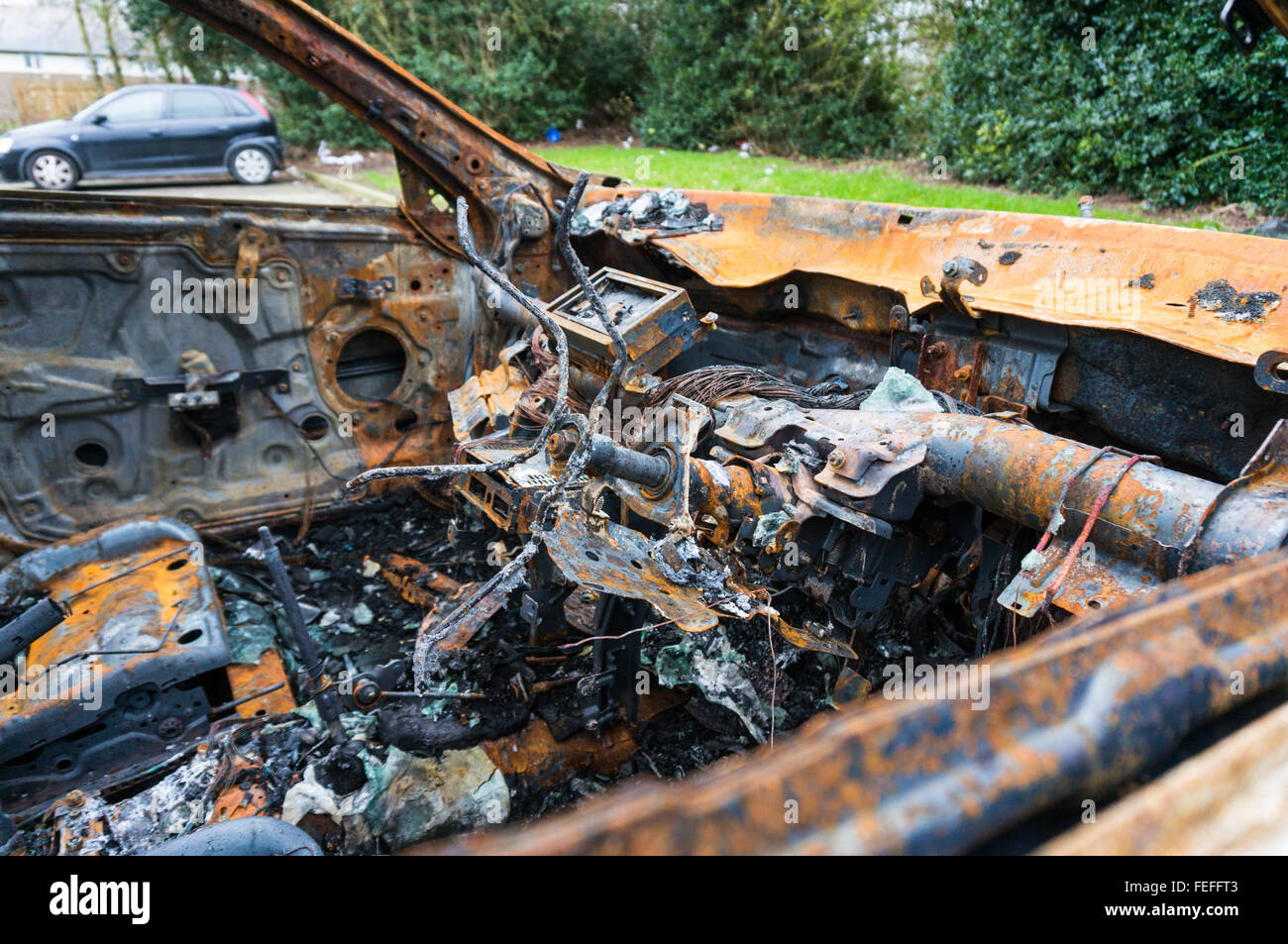Inside of an abandoned fire damaged car Stock Photo