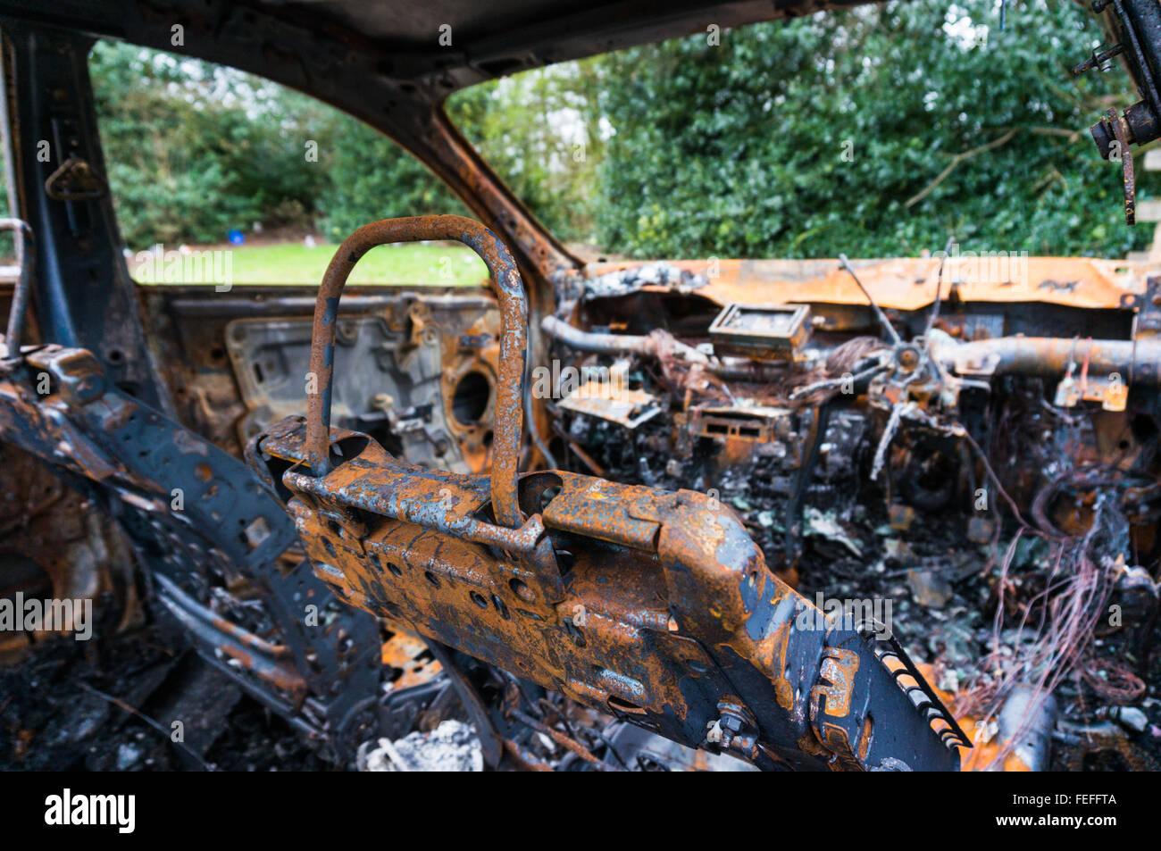 Inside of an abandoned fire damaged car - Stock Image