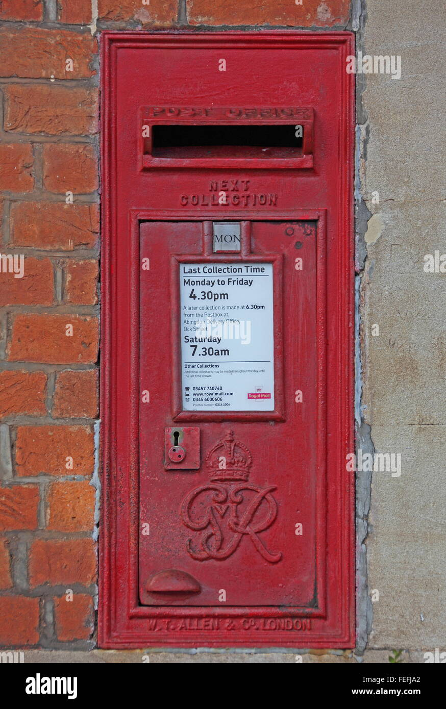 An old post office letter box bearing the royal initials of King George and this box is sunken into a wall of Culham - Stock Image