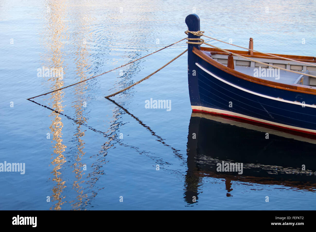 Anchored boat - Stock Image