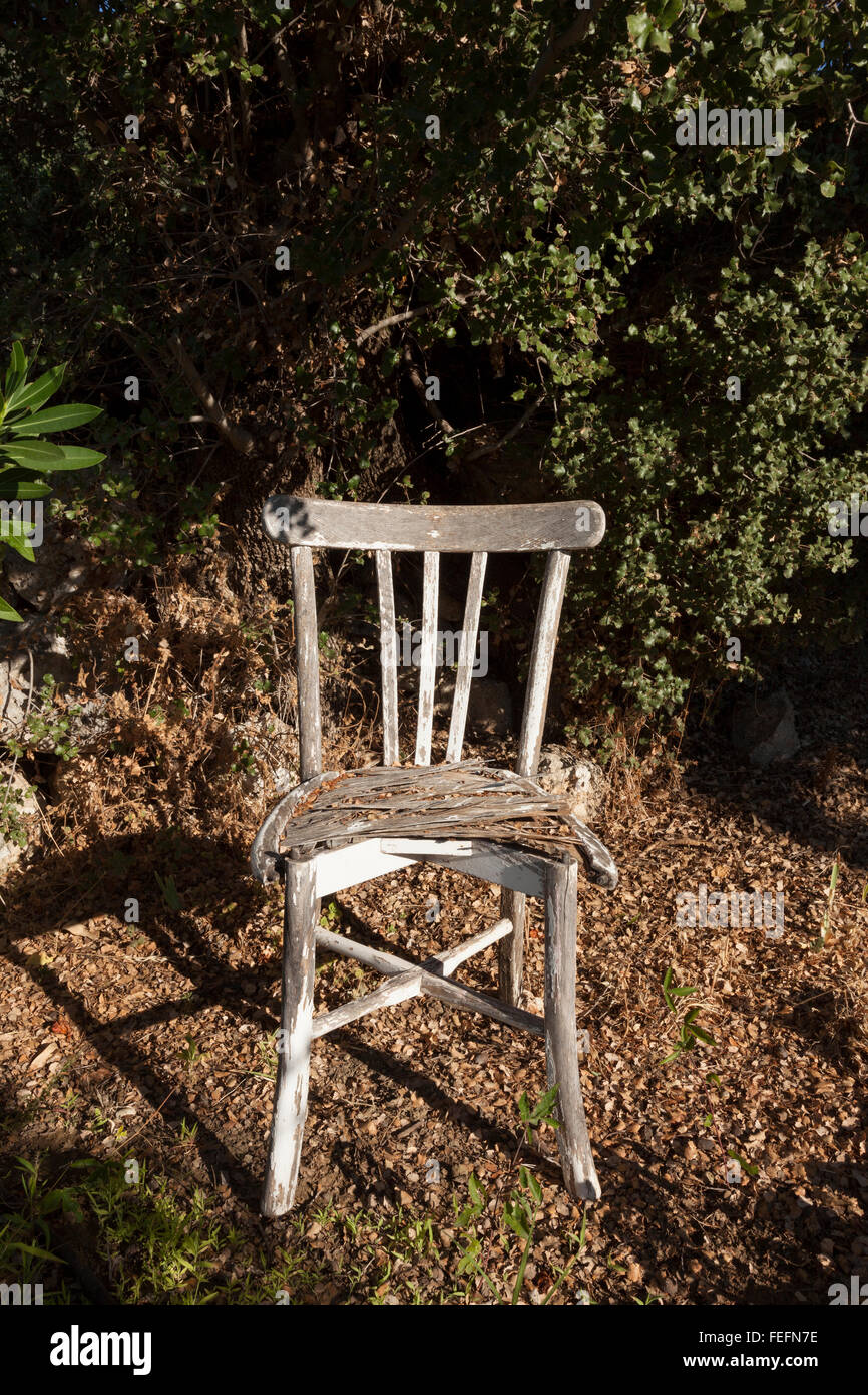Old chair in outdoor setting - Stock Image