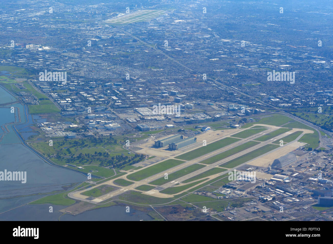 Moffett Field and San Jose Airport, Silicon Valley CA (aerial) - Stock Image