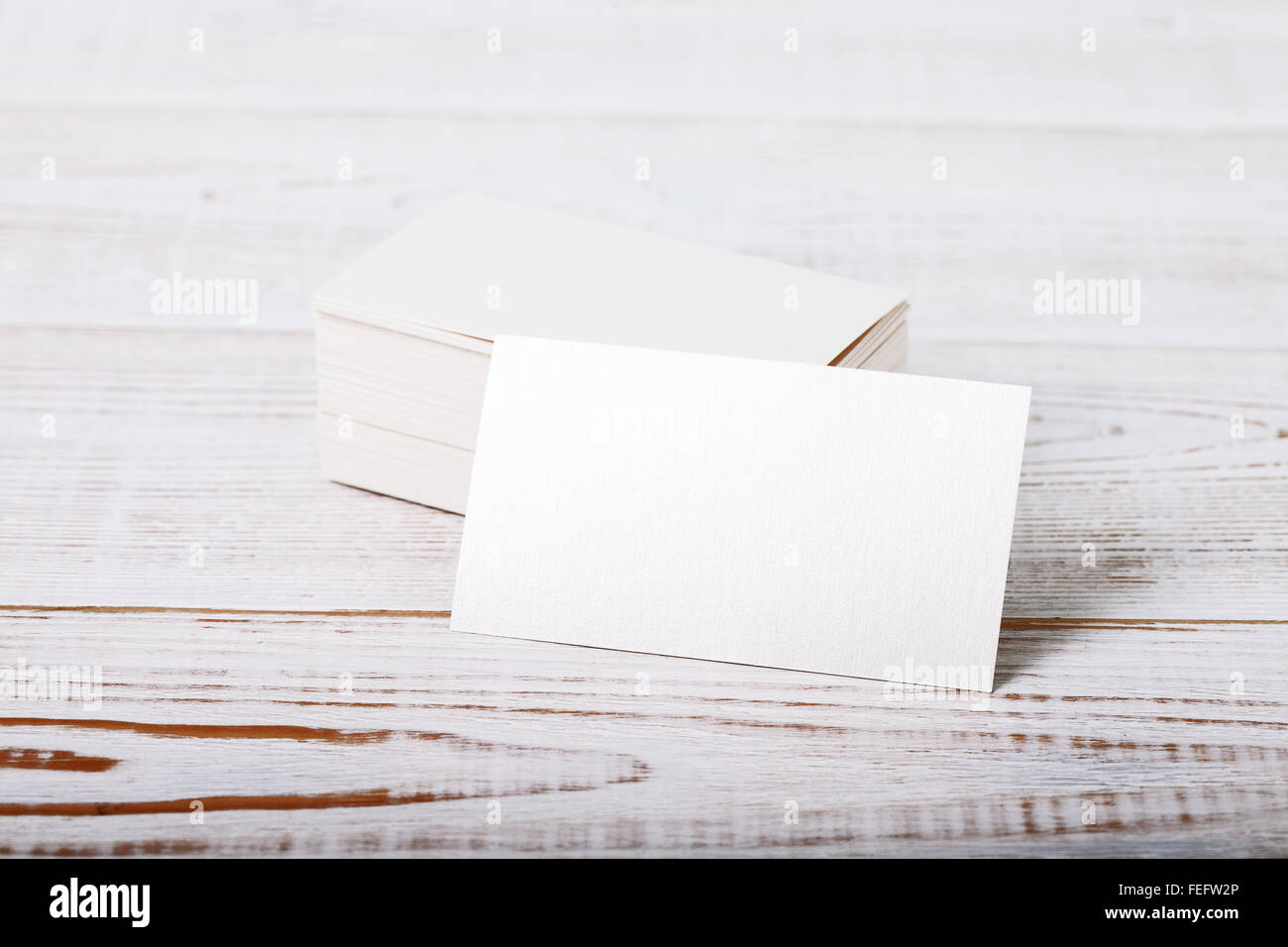 Thick white cotton paper business card mock up on vintage wooden ...