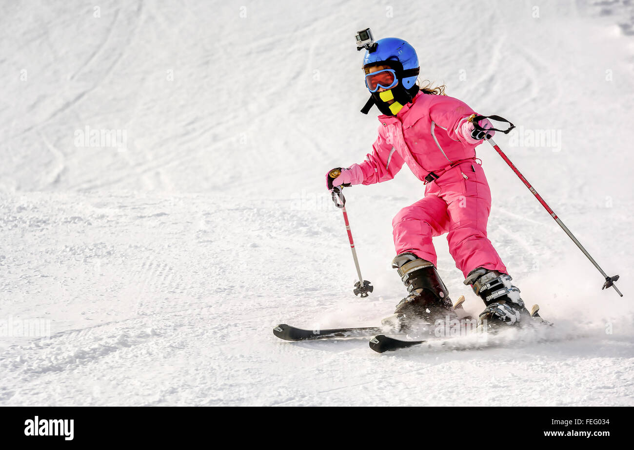 Little girl skiing fast downhill - Stock Image