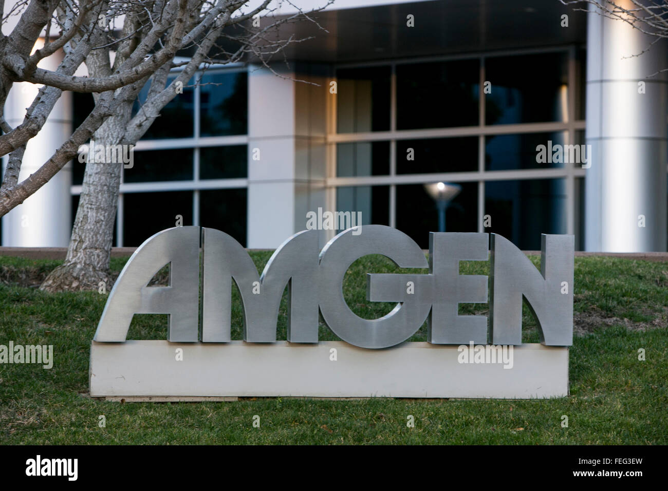 A logo sign outside of an office building occupied by Amgen