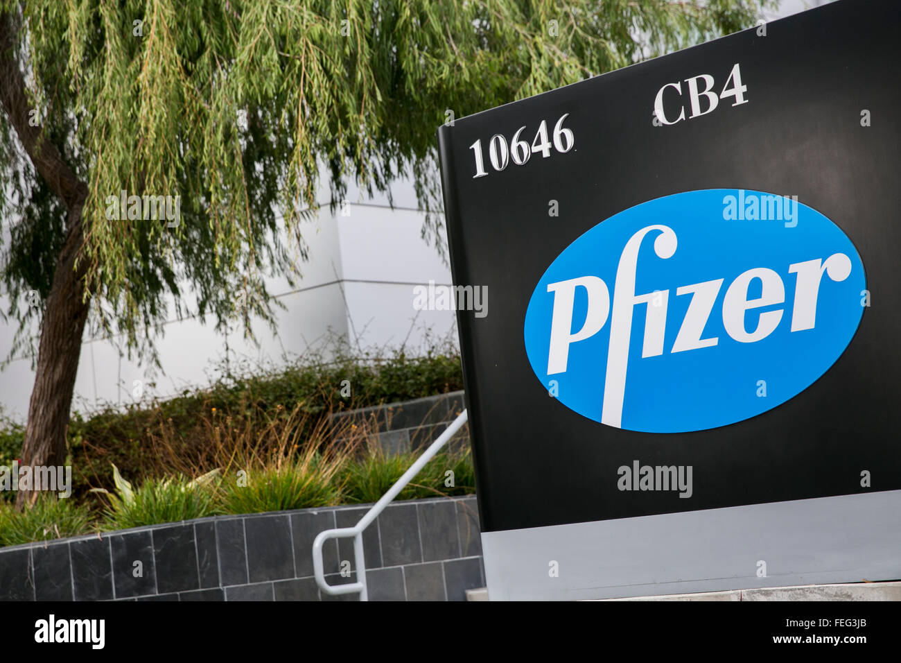 A logo sign outside of a facility occupied by Pfizer Inc