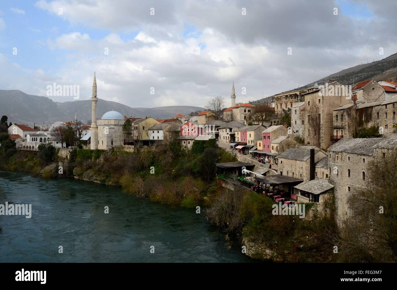 Mostar city with Ottoman Turkish mosque minaret medieval architecture Neretva river Bosnia Herzegovina - Stock Image