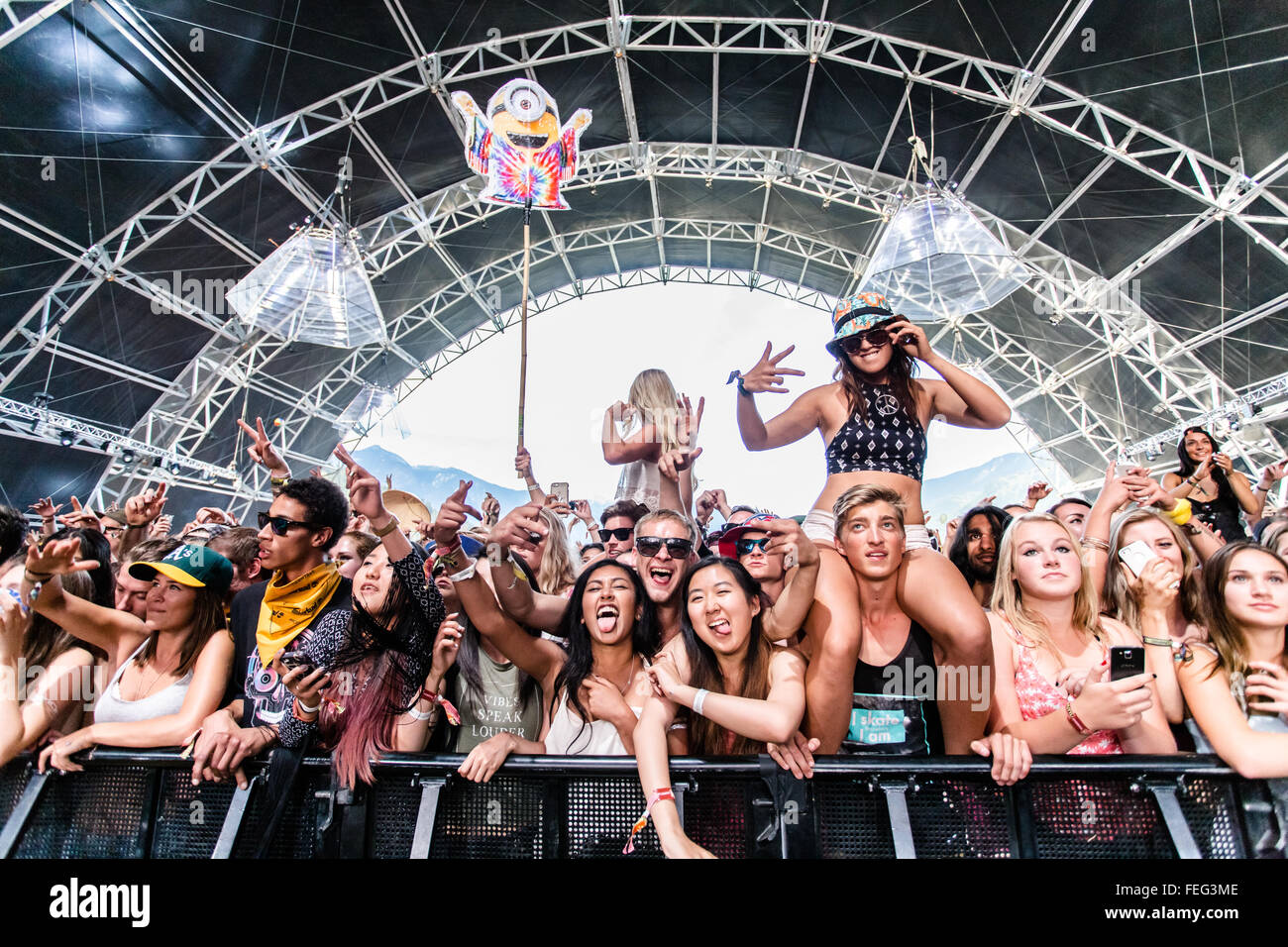 Shot of a crowd dancing inside a festival tent during an outdoor EDM show in 2015 - Stock Image