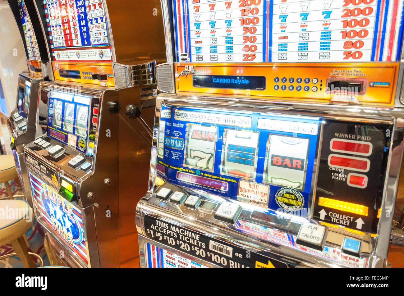 Slot machines in casino on board Royal Caribbean 'Brilliance of the Seas' cruise ship, Mediterranean, Europe Stock Photo