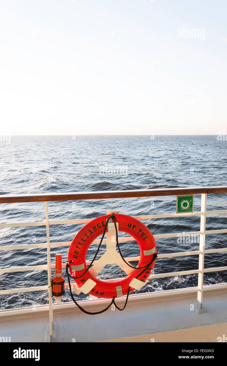 Lifesaving buoy on deck at sunset, Royal Caribbean's 'Brilliance of the Seas' cruise ship, North Sea, - Stock Image