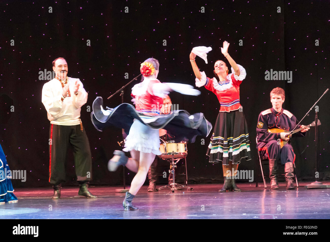 Russian folk dancers performing in The Pacifica Theatre, Royal Caribbean's Brilliance of the Seas cruise ship, - Stock Image