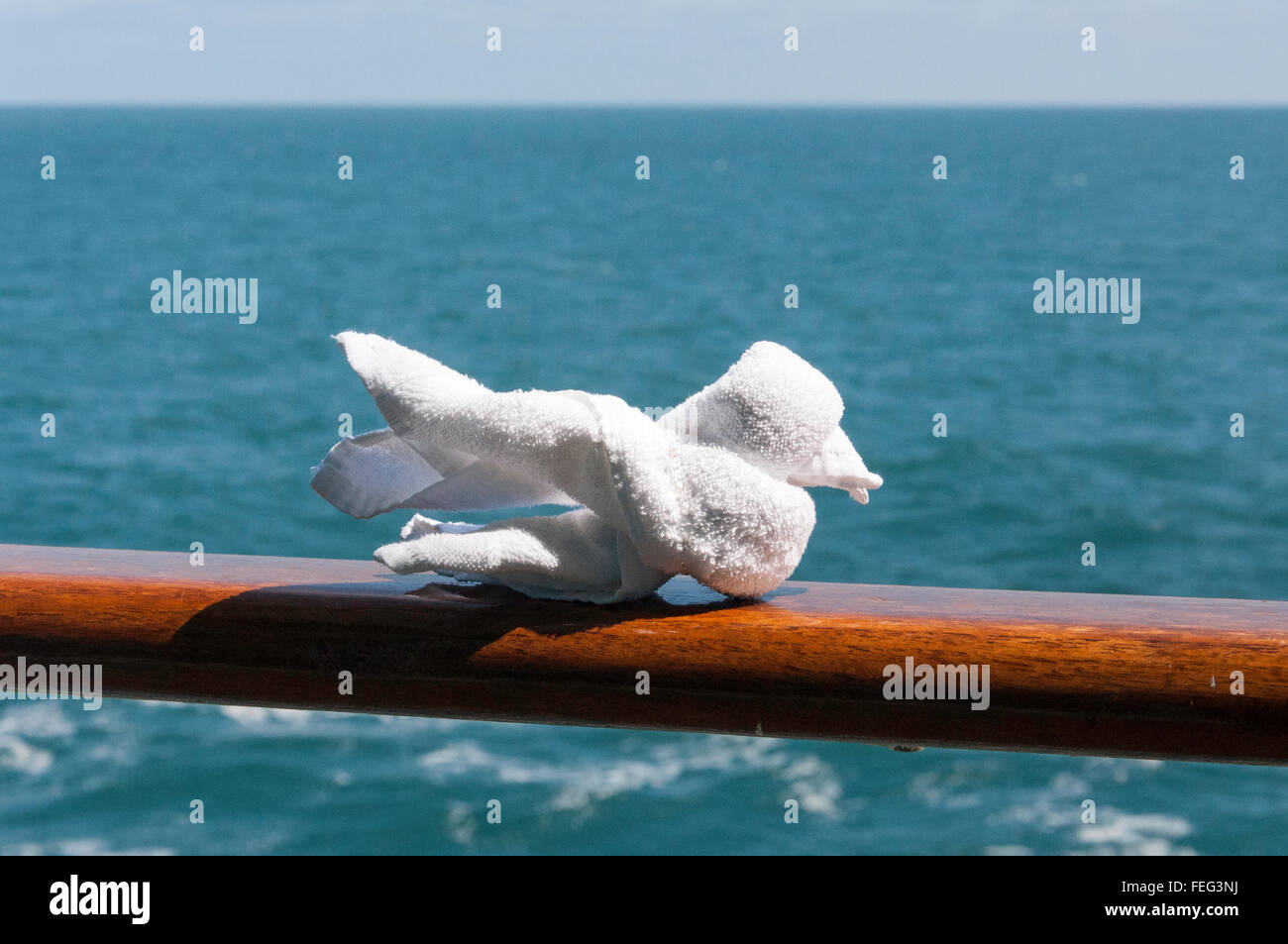 A towel seagull sculpture on ships railling, Royal Caribbean's Brilliance of the Seas cruise ship, North Sea, - Stock Image