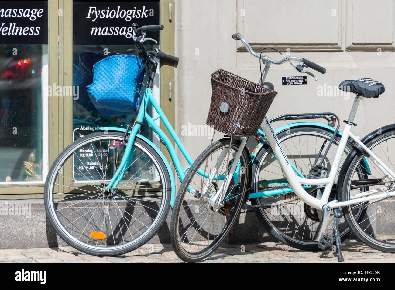 Bicycles parked by wall, Admiralkaj, Toldbodgade, Copenhagen, Hovedstaden Region, Kingdom of Denmark - Stock Image