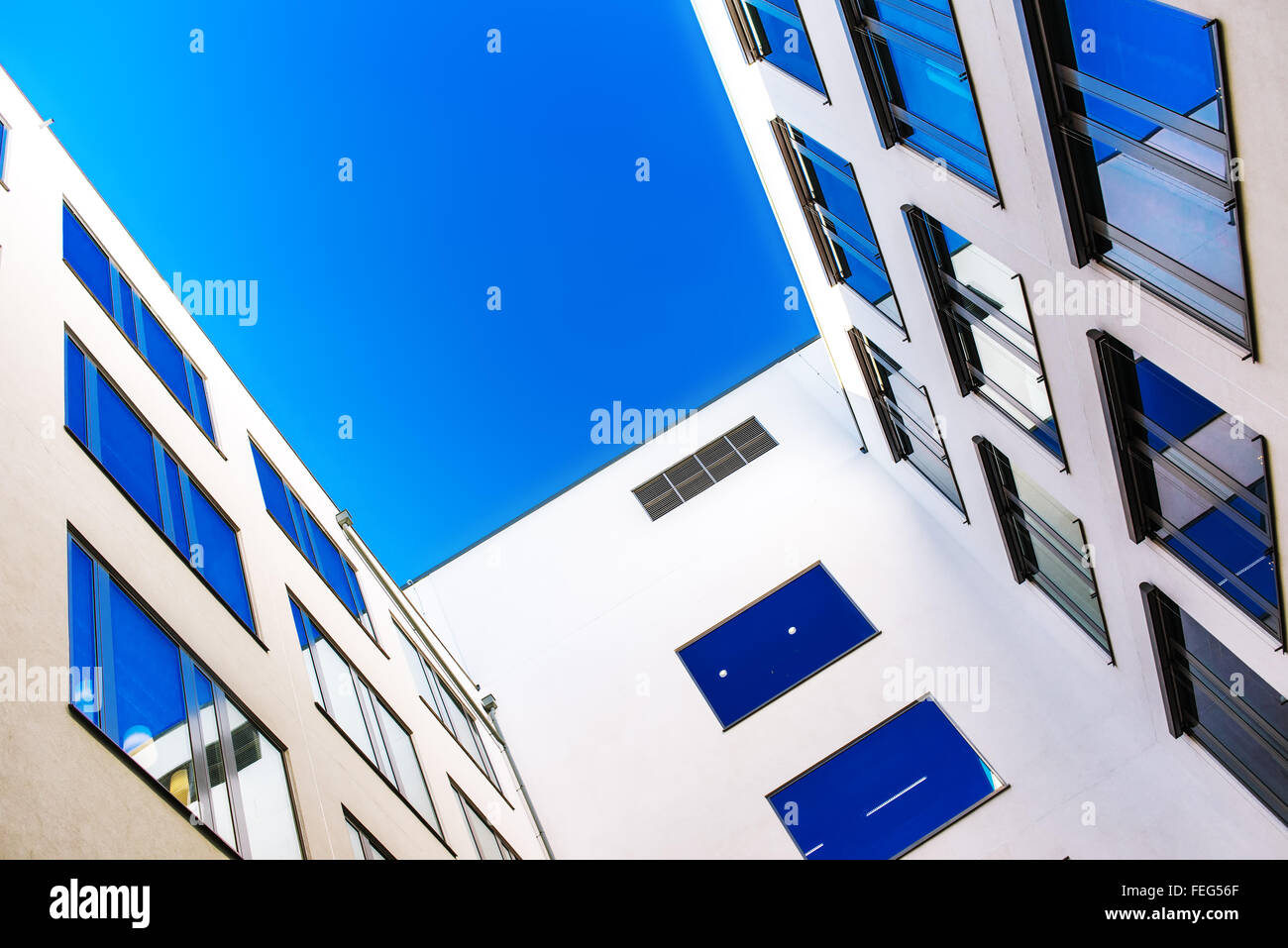 Residential building detail, modern architecture with blue sky as copy space - Stock Image