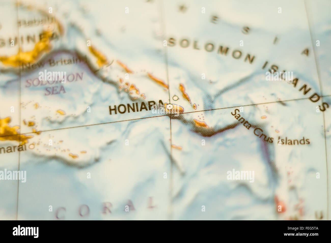 Photo of a map of Solomon Islands and the capital Honiara . - Stock Image