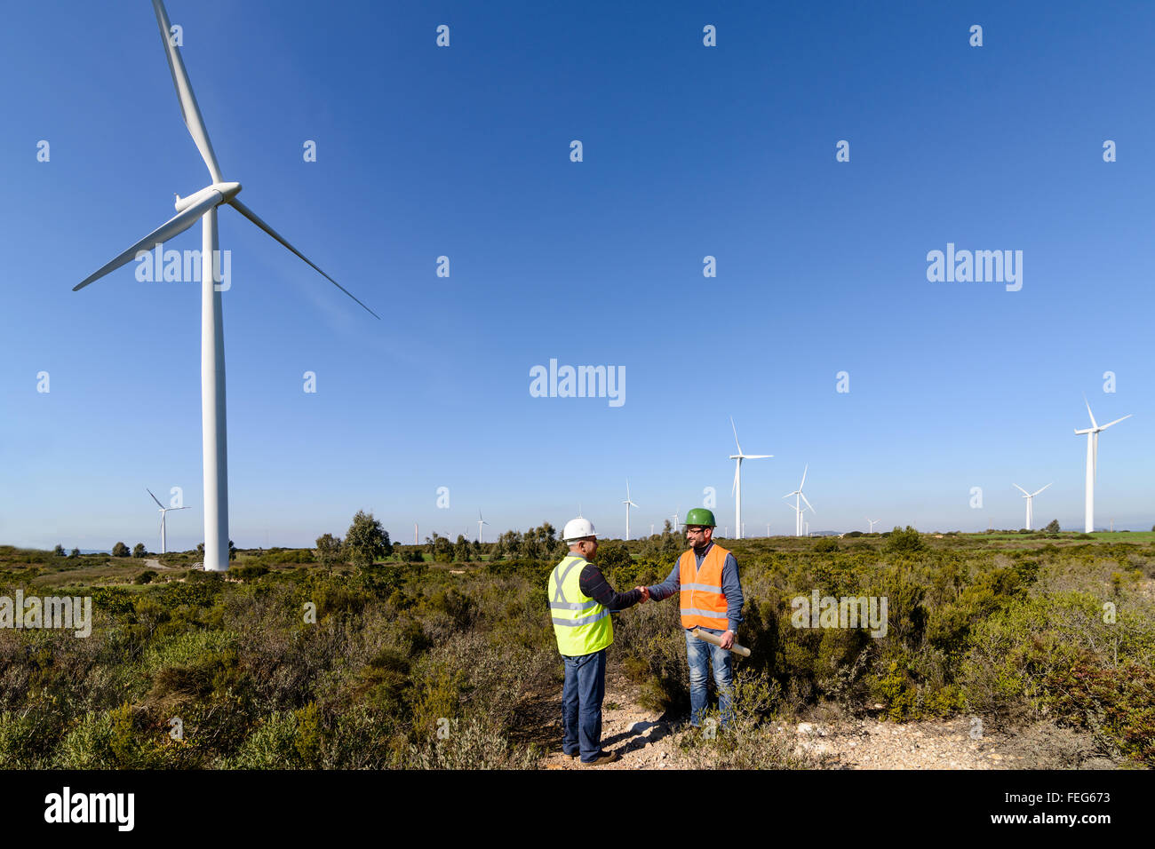 Engineers of wind turbine control projects and production. - Stock Image