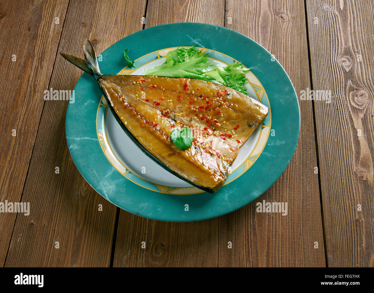 Craster kipper Deviled.smoked fish. Traditional British snack - Stock Image