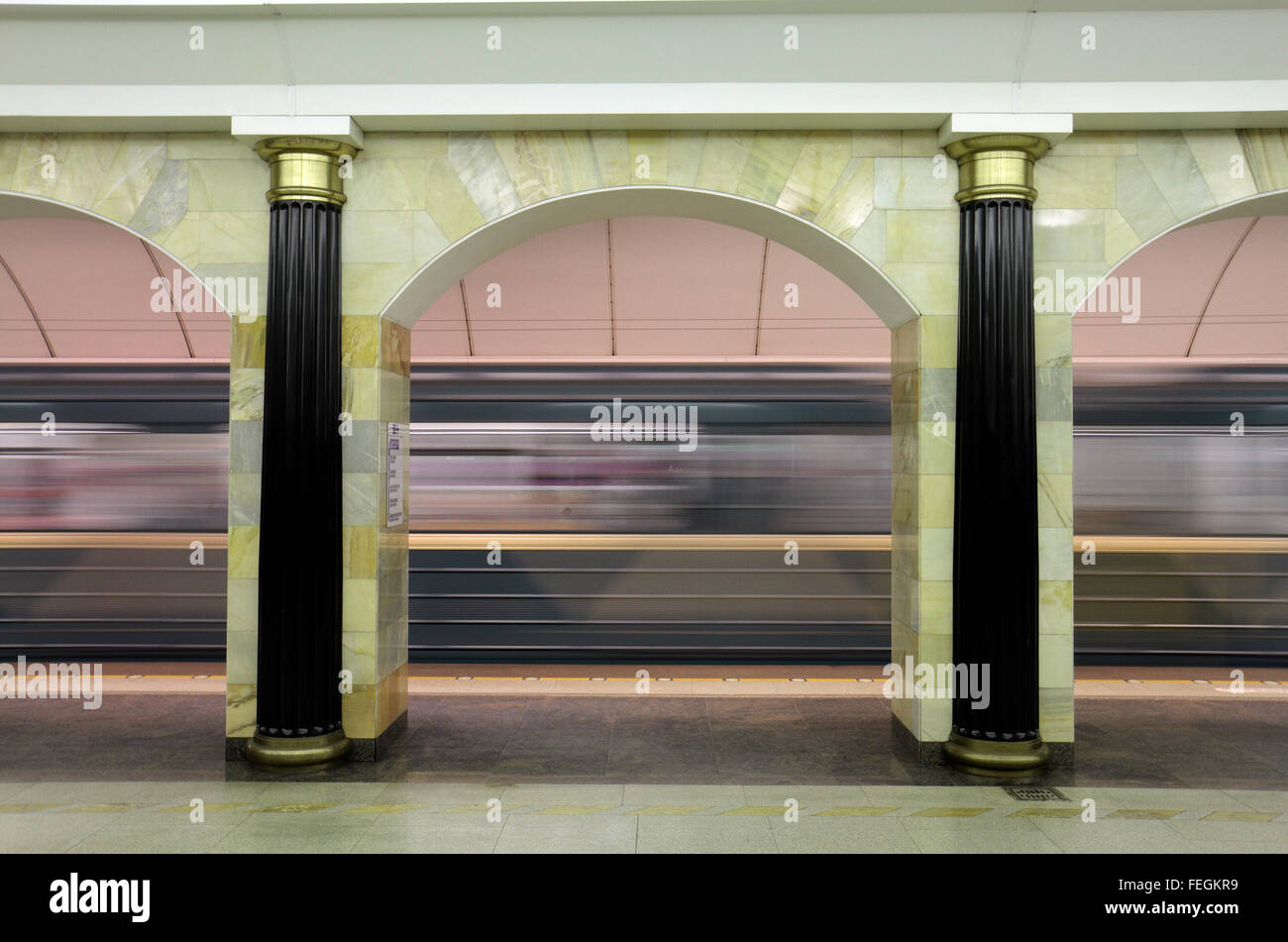 A Metro train accelerating away from the platform in the Admiralteyskaya Metro Station, Saint Petersburg, Russia. - Stock Image