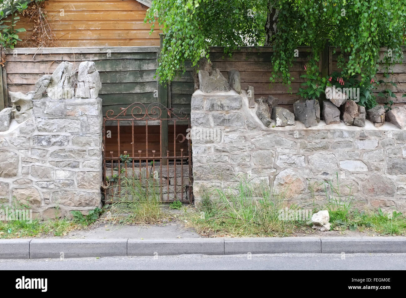 Obscured garden gate, leading into nowhere. - Stock Image