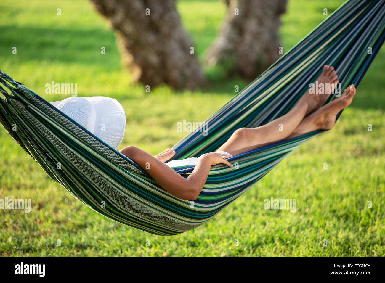 Relaxing in the hammock. Summer day. - Stock Image