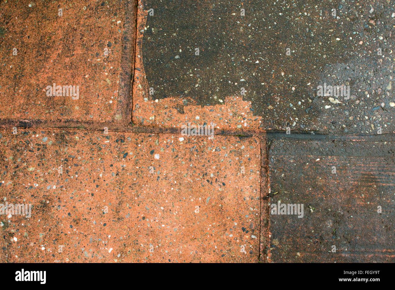 Dirty patio - demonstating before and after power washing - Stock Image
