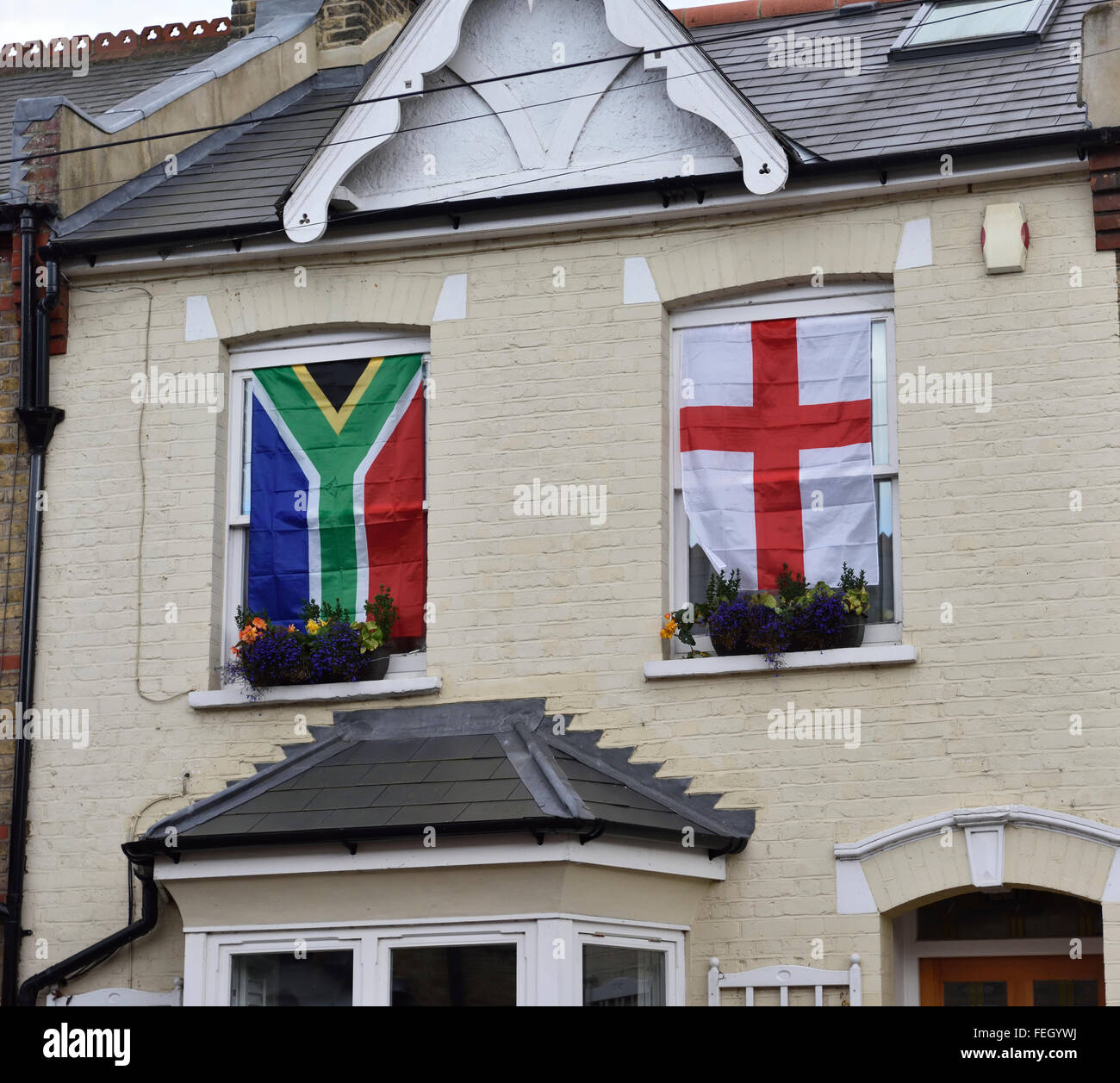 Flying the English flag on houses, garages, windows in Twickenham during the 2015 Rugby World Cup - Stock Image