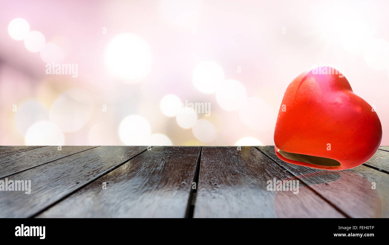 Heart shape on wooden table texture and beautiful background. - Stock Image