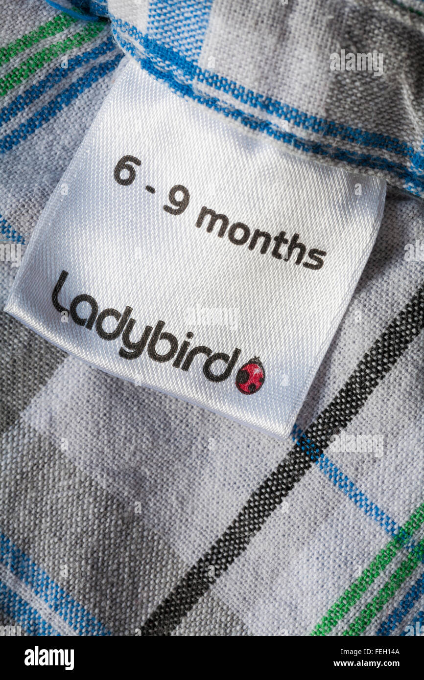 6-9 months Ladybird label in toddlers shirt - Stock Image