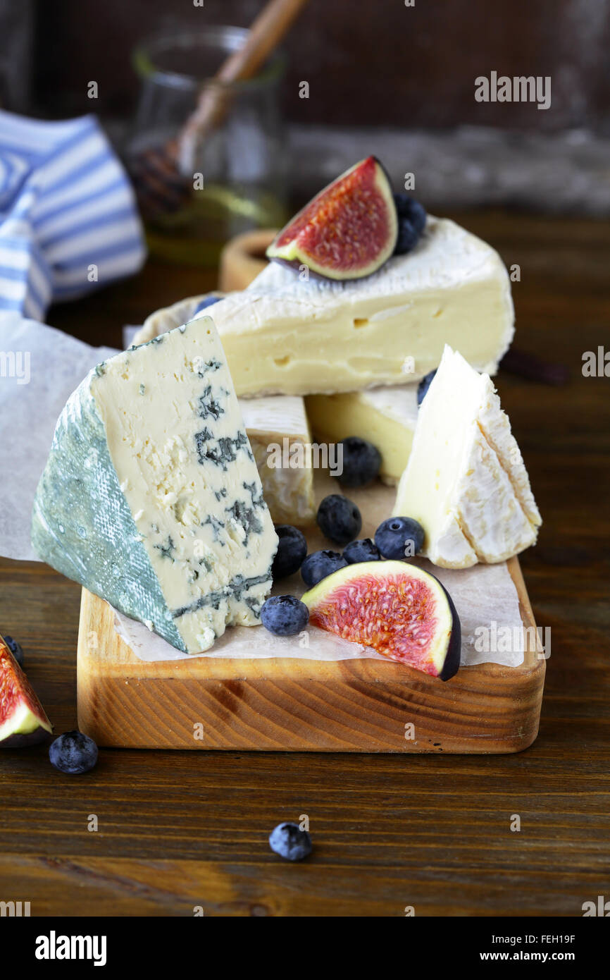gourmet cheese mix on board, food closeup Stock Photo