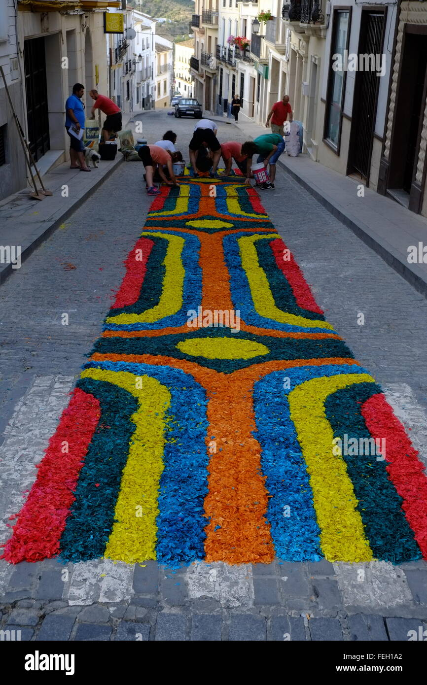 Corpus Christi. Carpets of colour dyed sawdust are laid though the town. Later a religious procession happens. Carcabuey, Stock Photo